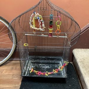 Chateau shaped bird cage in black with 5 toys